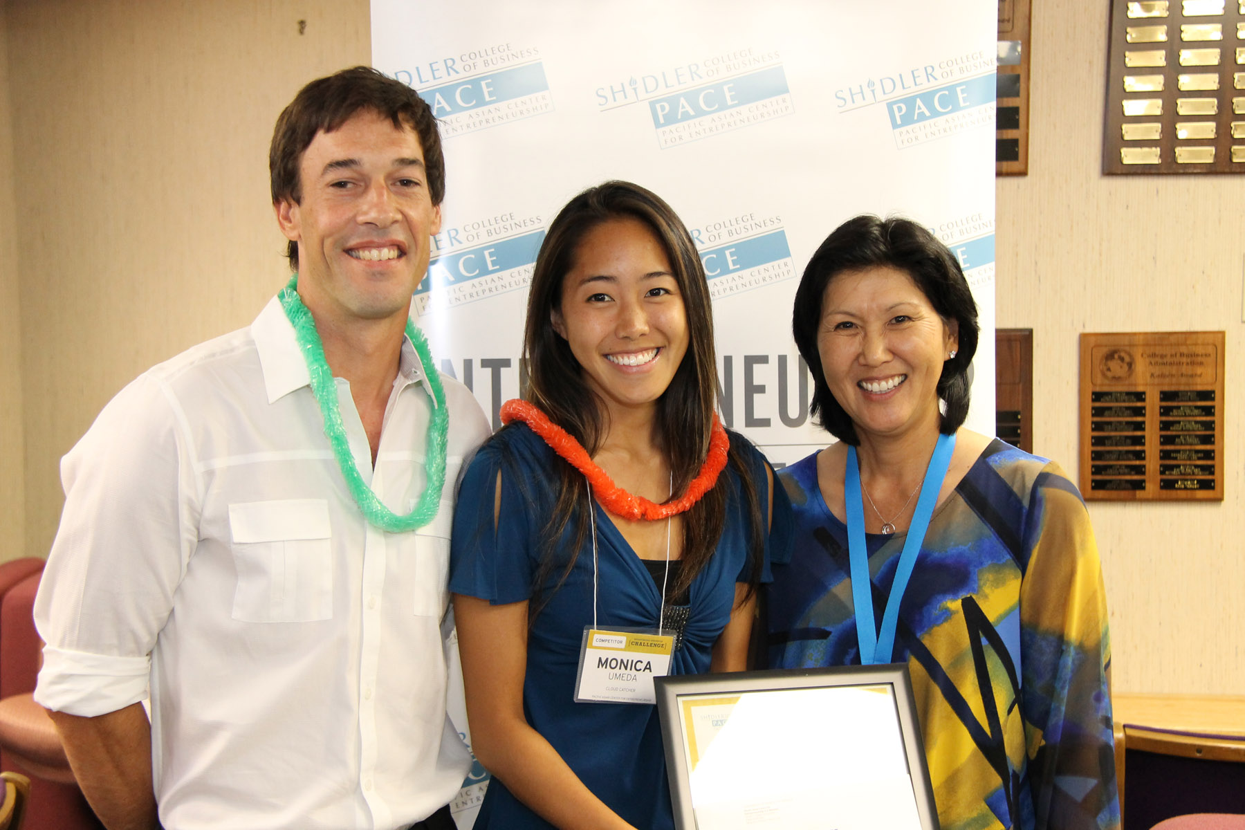 Francis Newton Parks, III and Monica Umeda accept the first place prize in the Biomimicry-themed Breakthrough Innovation Challenge from PACE executive director Susan Yamada (far right).