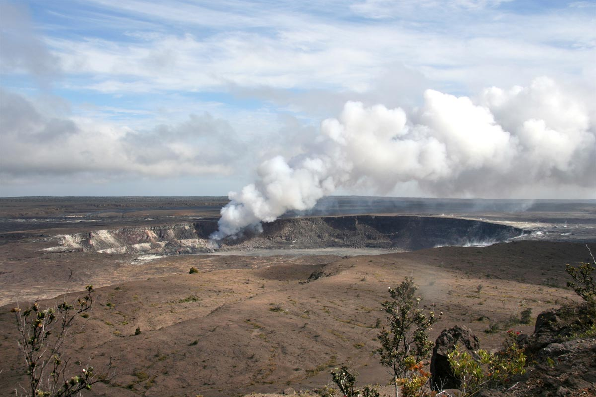 View of eruption plume from Overlook vent in Halema'uma'u crater on the summit of Kilauea volcano on 27 March 2008, 9 days after the start of the ongoing eruption. Credit: Christine Heliker, Hawaiian Volcano Observatory, U.S. Geological Survey.